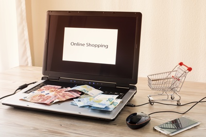 Laptop mit Geldscheinen